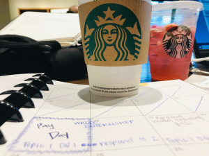 starbucks cup on a notebook studying.
